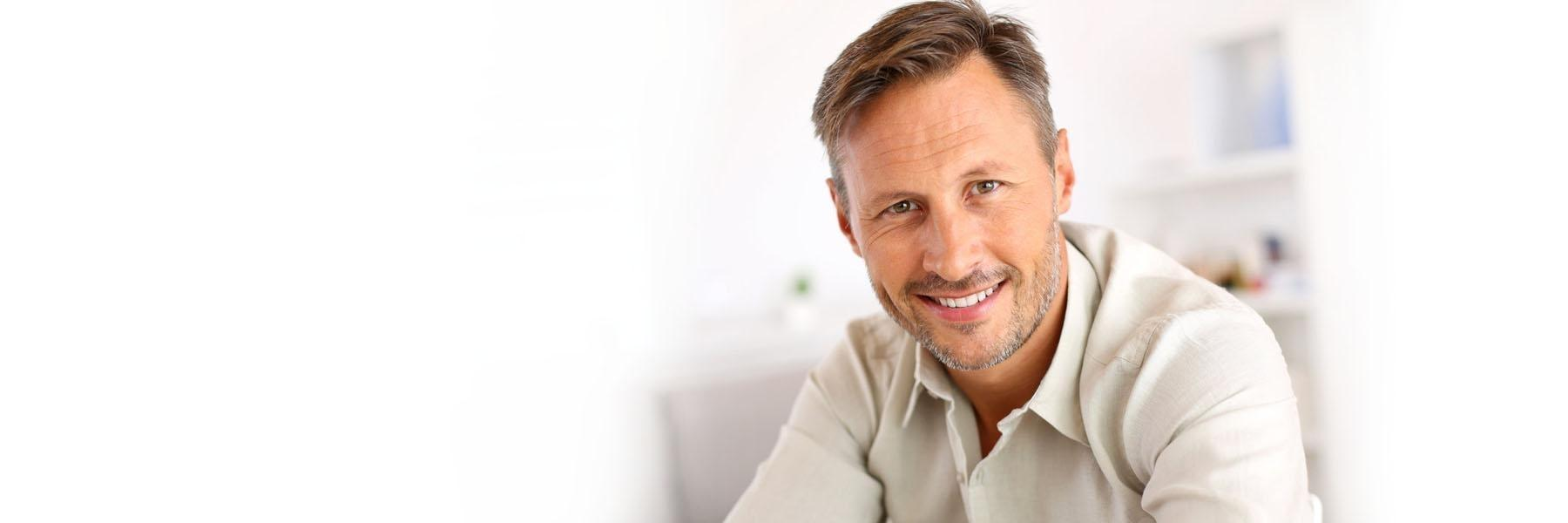 man smiling after cosmetic dentistry appointment in monroe