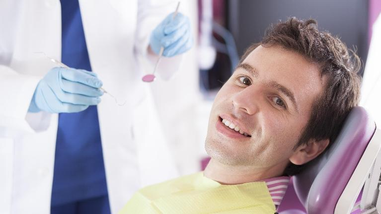 A Man Sits In The Exam Chair | Monroe Township Dentist