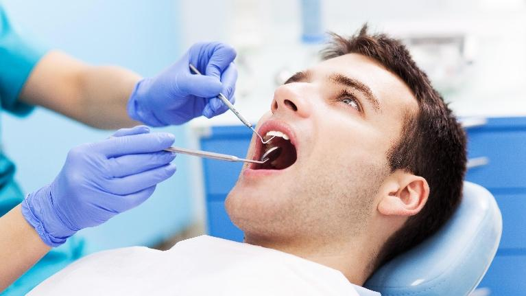 Man Getting Dental Exam | Monroe Dental Arts