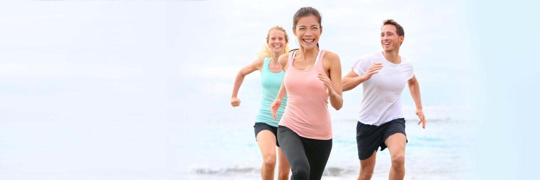 man and two women running on beach | monroe township nj mouthguards